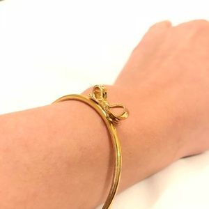 Kate spade gold plated bow bangle